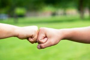 03-touch-athletes-fist-bump